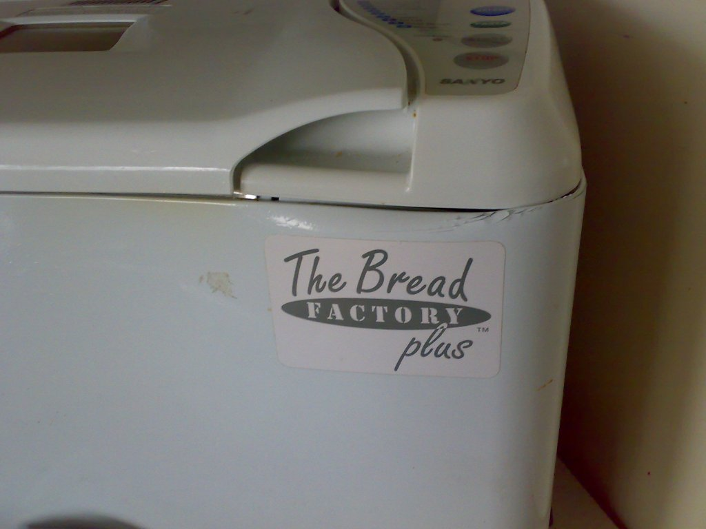 This dented bread machine needs to be covered with a thick towel when baking bread, to stop the draught that made uneven loaves.