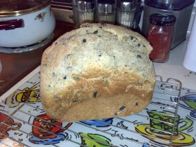 Olive brine adds flavour, and higher water-to-flour ratio makes this chewy, tasty loaf.