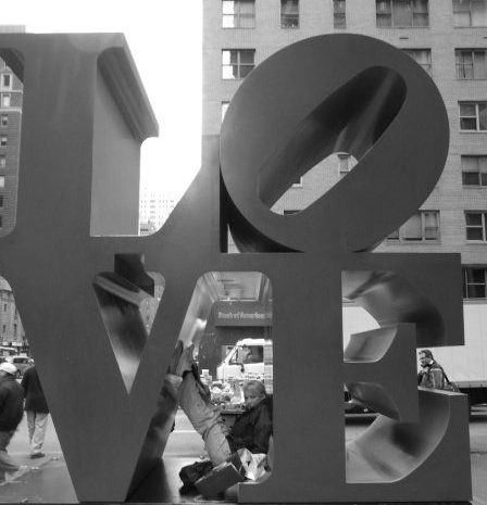 British singer Carolyn Fenna Arrowsmith  gets inside Robert Indiana's  LOVE sculpture in NYC.